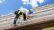 photodune-204073-man-working-on-roof-installing-rails-for-solar-panels-s