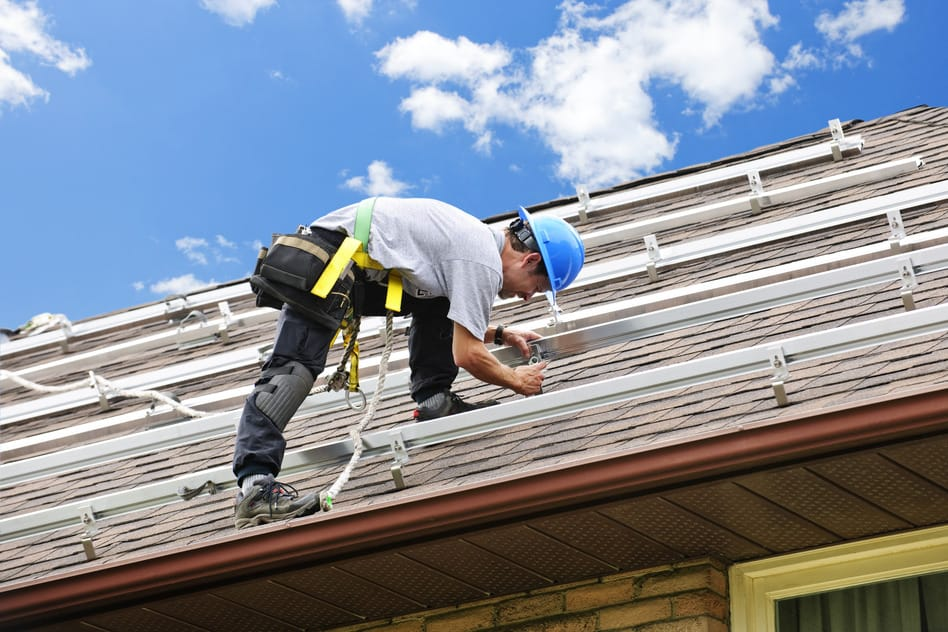 photodune-204073-man-working-on-roof-installing-rails-for-solar-panels-s